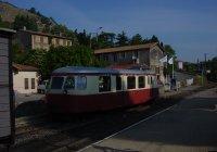 Billard auto rail chugs past thr fourgon at Tournon