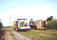 The weed spray train and the Plasser Tamping Machine cross at Cowley, Mar-07.